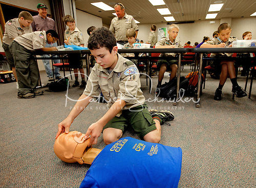 Photo: Boy Scouts earn their first aid merit badge.