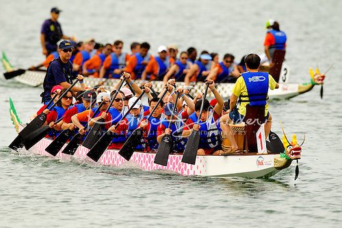 Teams power their dragon boats toward the starting line during the 2012 Dragon Boat Races in Charlotte NC.