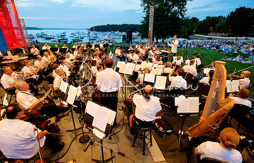 Photo of the Charlotte Symphony in an outdoor summer pops performance. The Charlotte Symphony is the largest and most active professional performing arts organization in the central Carolinas