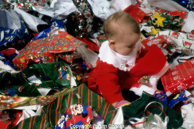 Image result for baby playing with wrapping paper