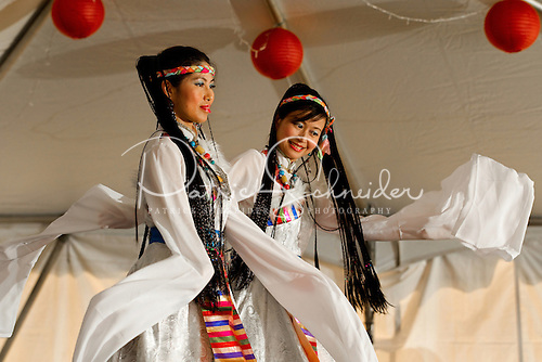Two Asian dancers perform on stage at the 2012 Charlotte Asian Festival, held May 5, 2012 in Ramsey Creek State Park in Huntersville, NC.