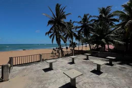 Empty tables near a beach