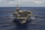 The aircraft carrier USS Carl Vinson transits the Pacific Ocean.
