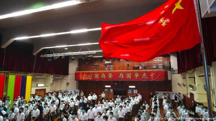 "Hong Kong ""National Security Education Day"" students raise the flag and sing the national anthem"