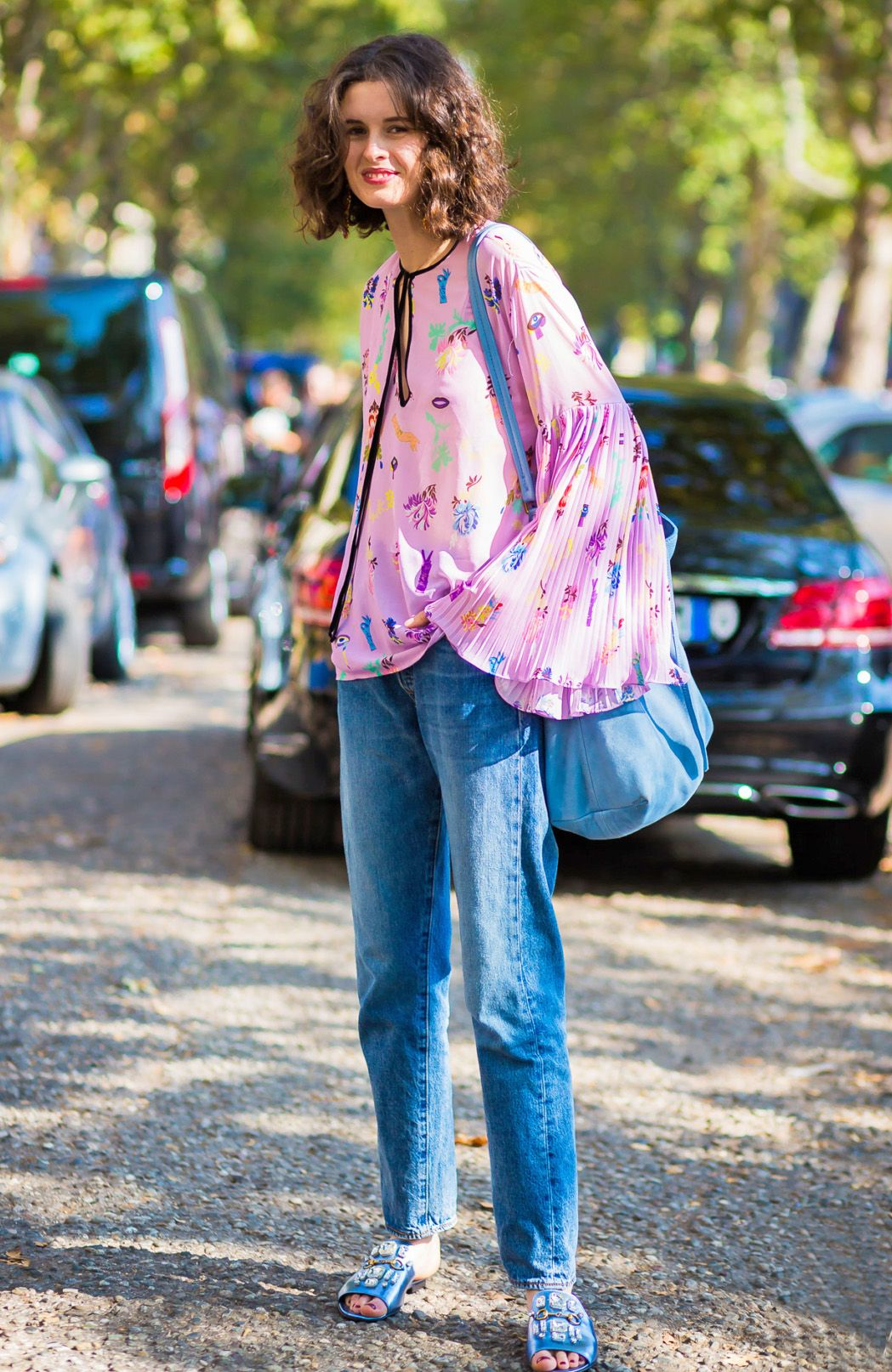 Not sure how to wear jeans in the summer? Pair the denim with a lightweight,  billowy blouse.