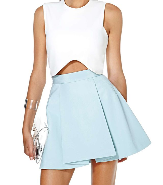 There's a reason apple-shaped women gravitate to pleated skirts like this ice blue one; they create structure to camouflage the stomach.  Cameo Gerome Skirt ($138)