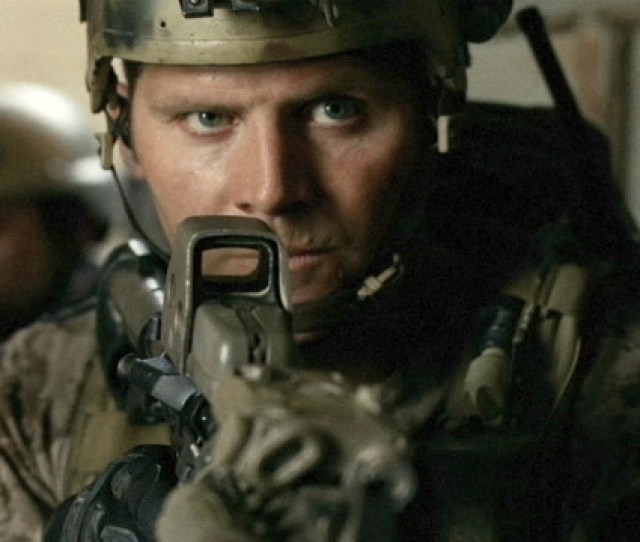 A Soldier Takes Aim In A Scene From Act Of Valor