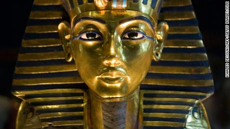 (FILES) -- A picture taken on October 20, 2009 shows King Tutankhamun's golden mask displayed at the Egyptian museum in Cairo. DNA testing has unraveled some of the mystery surrounding the birth and death of pharaoh king Tutenkhamun, revealing his father was a famed monotheistic king and ruling out Nefertiti as his mother, Egypt's antiquities chief said on February 17, 2010.  AFP PHOTO/KHALED DESOUKI        (Photo credit should read KHALED DESOUKI/AFP/Getty Images)