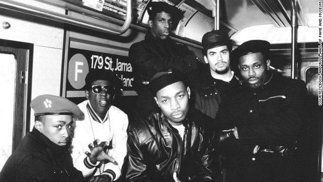 The original members of Public Enemy pose in a New York City subway car.