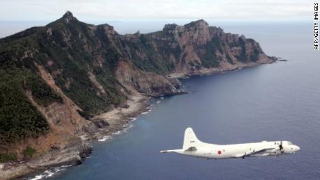 A Japanese military plane flies over the Senakuku / Diaoyu islands in this file photo.