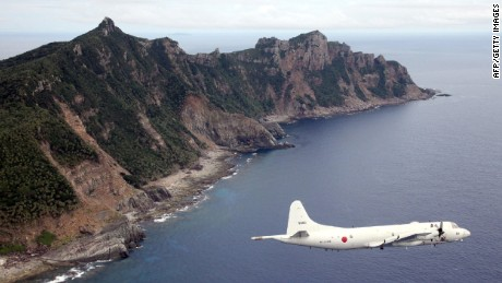 A Japanese Self-Defense Force aircraft flies over the Senkaku Islands in this file photo.