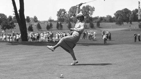 Zaharias urges the ball into the hole on the 18th green of Chicago's Tam O'Shanter Country Club in the Women's All-American Golf Tournament in 1950.