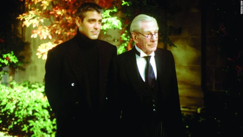 "George Clooney (seen here with Michael Gough in ""Batman & Robin"") was both the caped crusader and the sexiest man alive in 1997."