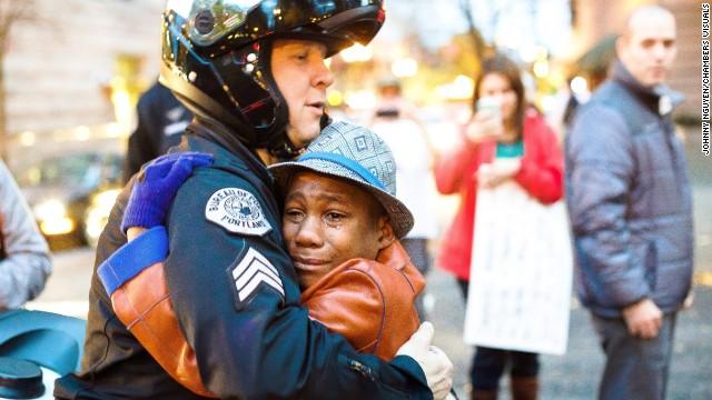 Devonte Hart, then 12, hugs Sgt. Bret Barnum at a rally in Portland, Oregon, in 2014.