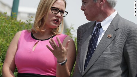 Then-Rep.  Kirsten Cinema and Rep. John Barrow, at left, are seen outside the US Capitol in Washington, DC in May 2014.