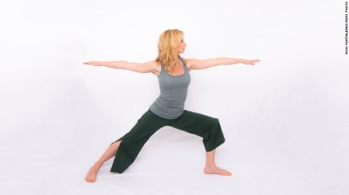 Step your right leg back, as though you are coming into a lunge position, but drop the right heel and point the toes out to almost 90 degrees. Keep your right leg straight with your left knee bent to align above your ankle. With your shoulders aligned above your hips, reach your right arm back and left arm forward with your palms down. Look past your front hand and take five long, deep breaths. Repeat on the other side.
