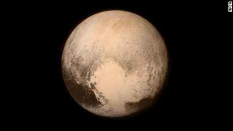 What does Pluto's ocean keep from freezing?