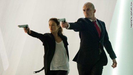 """Hannah Ware as Katia and Rupert Friend as the assassin star in """"Hitman: Agent 47."""""""