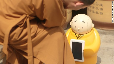 Robot monk dispenses Buddhist wisdom at Beijing temple