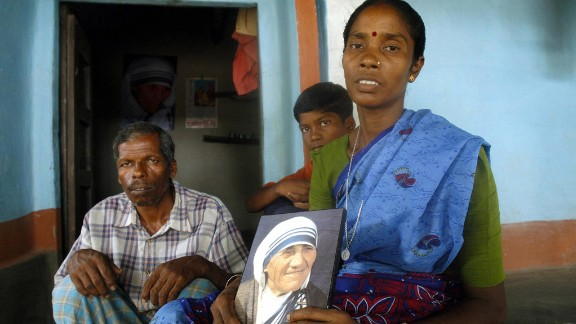 Monica Besra sits with members of her family in her home village of Nakur at Manirampur, some 450kms north of Kolkata.