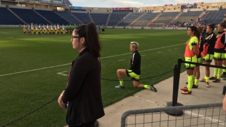 Seattle Reign midfielder Megan Rapinoe takes a knee as the National Anthem is sung ahead of the Reign's match with the Chicago Red Stars.