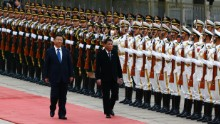 President of the Philippines Rodrigo Duterte and Chinese President Xi Jinping review the honor guard as they attend a welcoming ceremony at the Great Hall of the People on October 20, 2016 in Beijing, China.