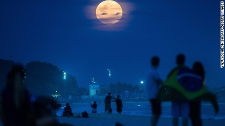 "The full moon, nicknamed ""the supermoon"", rises at Ipanema beach in Rio de Janeiro, Brazil, on August 10, 2014. A supermoon is the coincidence of a full moon or a new moon with the closest approach the Moon makes to the Earth on its elliptical orbit, resulting in the largest apparent size of the lunar disk as seen from Earth. AFP PHOTO / YASUYOSHI CHIBA        (Photo credit should read YASUYOSHI CHIBA/AFP/Getty Images)"