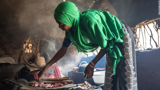 Batulo makes bread in a small kitchen at the Kakuma camp. Now that her parents and siblings have left, she's staying with another family to make sure she has enough food.