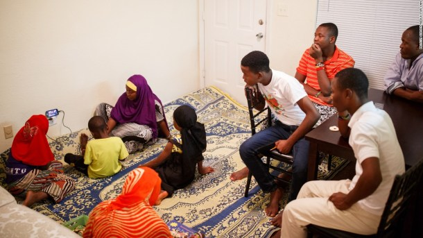 Abdalla and his family don't have a TV, so they relax in their living room by watching videos on a cell phone.