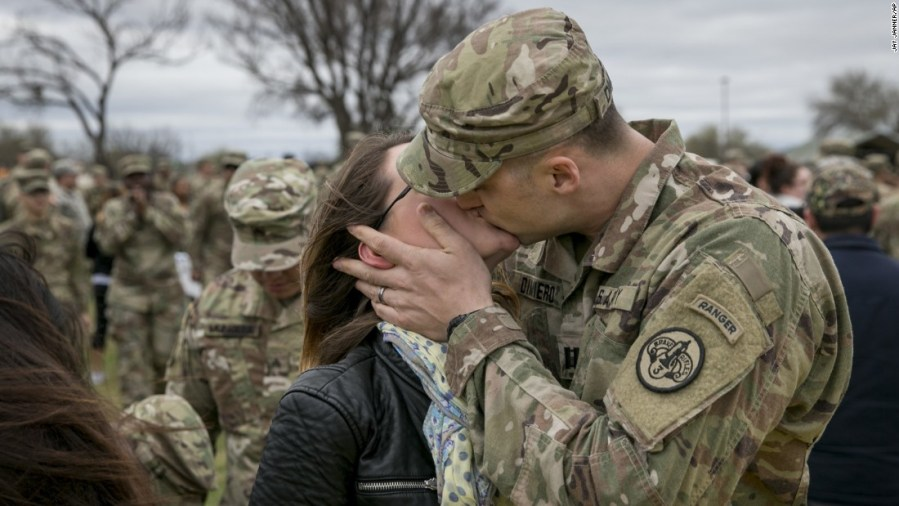 US military photos from February Army Capt  Thomas DiMiero kisses his wife  Jennifer  during a welcome home