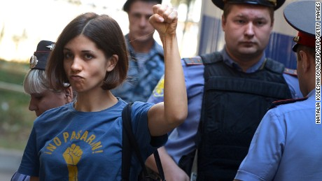 "Member of female punk band ""Pussy Riot"" Nadezhda Tolokonnikova gestures before a court hearing in Moscow on August 8, 2012."