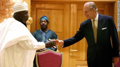 Prince Philip toasts then-Nigerian President Olusegun Obasanjo in  Abuja in 2003.