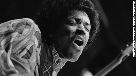 Jimi Hendrix is caught mid guitar break during his performance at the Isle of Wight Festival, August 1970.