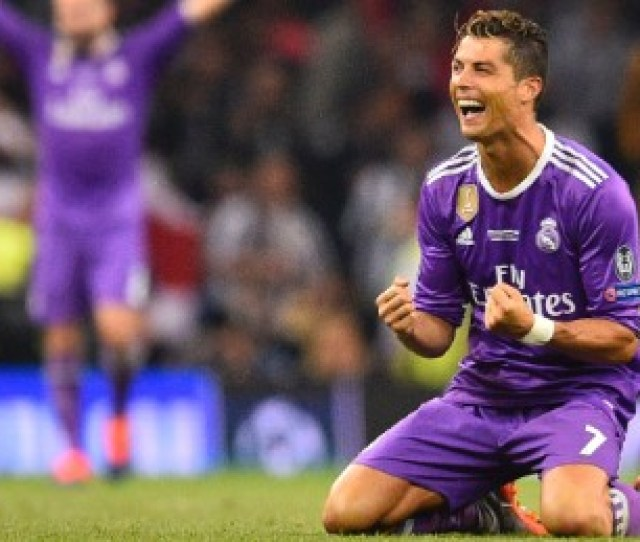 Real Madrids Portuguese Striker Cristiano Ronaldo Falls To His Knees As He Celebrates Their Victory On