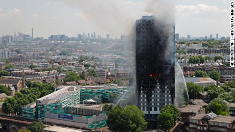 Smoke and flames billow from Grenfell Tower as firefighters attempt to control a blaze at the residential building on June 14, 2017.