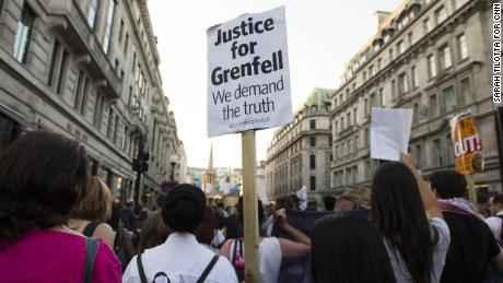 "Protesters march up Regent Street in London chanting ""Justice for Grenfell"" on June 16, 2017, two days after the fire."