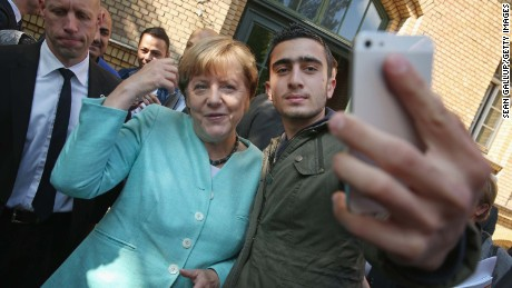 Angela Merkel poses for a selfie with Anas Modamani, a refugee from Syria on September 10, 2015 in Berlin, Germany.