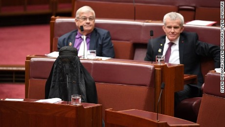 Pauline Hanson wears a burqa in Parliament, in a widely condemned stunt.