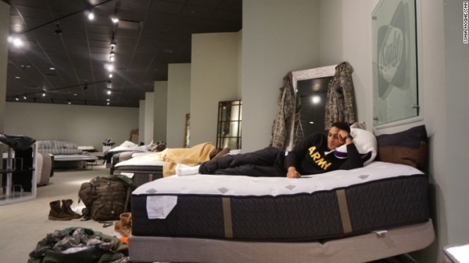 Aziz Shroff 23 With The Texas National Guard Rests On A Furniture