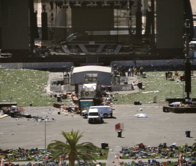 Debris Is Scattered On The Ground Monday October  At The Site Of A Photos Mass Shooting At Las Vegas Music Festival