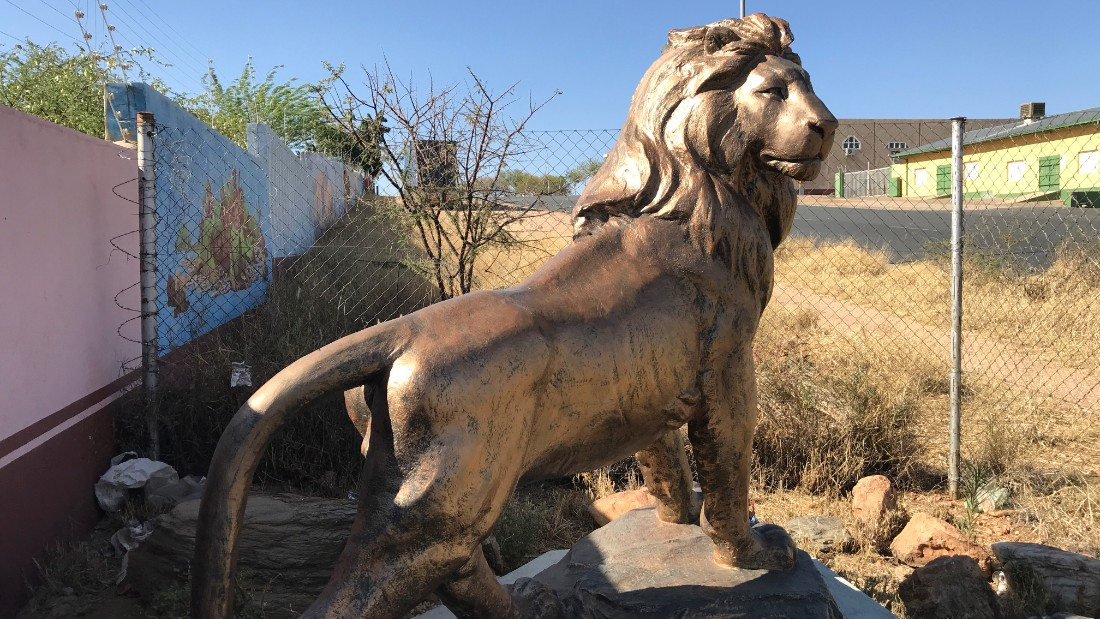 A statue of a lion outside the warehouse in Namibia.