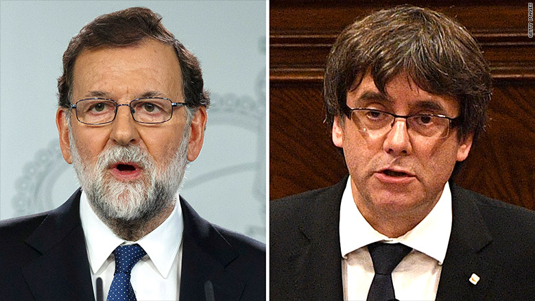 Rajoy (L) called Saturday for the removal of Catalan President Carles Puigdemont (R).