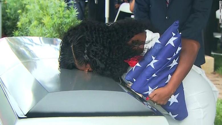 Sgt. La David Johnson's widow, Myeshia, kisses his casket before his burial Saturday.