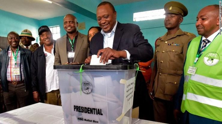 Kenya's President Uhuru Kenyatta casts his ballot.