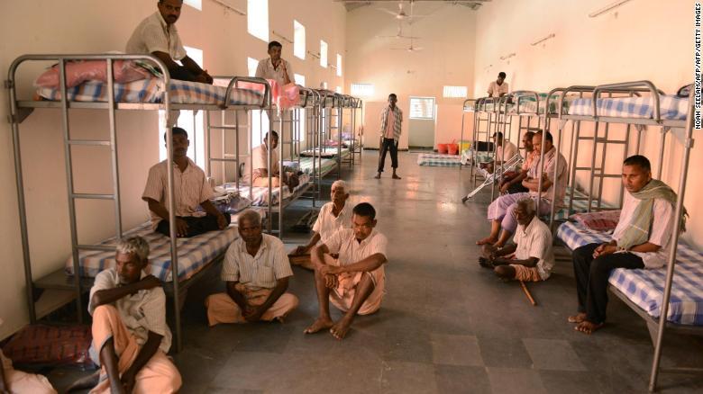 Beggars sit inside a dormitory in Hyderabad on November 8.
