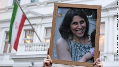 Supporters hold a photo of Nazanin Zaghari-Ratcliffe during a vigil outisde the Iranian Embassy on January 16, 2017.
