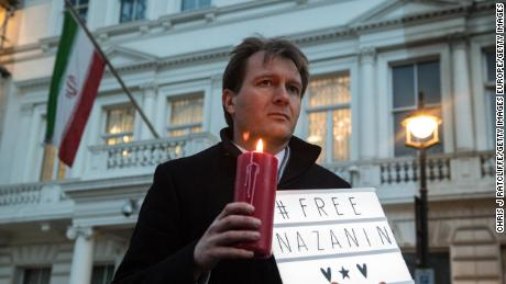 Richard Ratcliffe, husband of Nazanin Zaghari-Ratcliffe, holds a '#FreeNazanin' sign and candle during a vigil for her outisde the Iranian Embassy on January 16, 2017 in London, England.