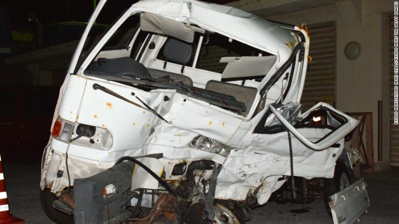 A wrecked light truck at a police station in Okinawa is seen on Sunday after it collided with a truck that authorities allege was driven by a US service member.