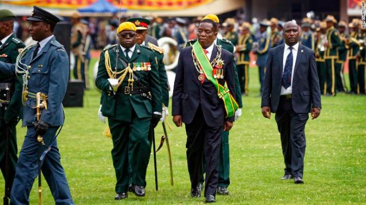 Emmerson Mnangagwa inspects the military parade after being sworn.