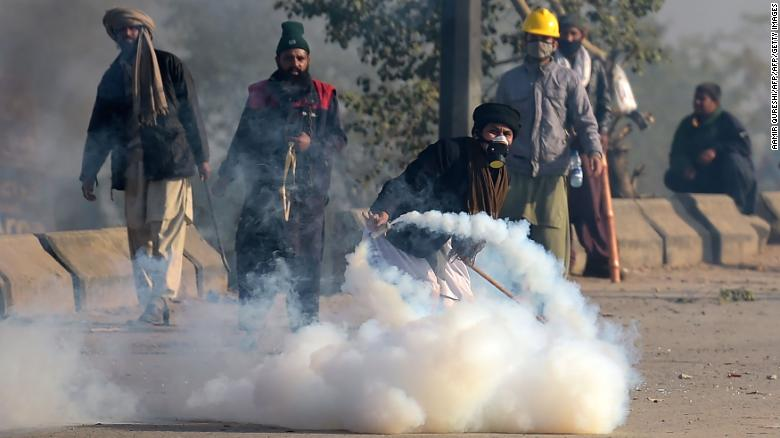 Protesters threw tear gas shells back to police during a clash on Saturday.